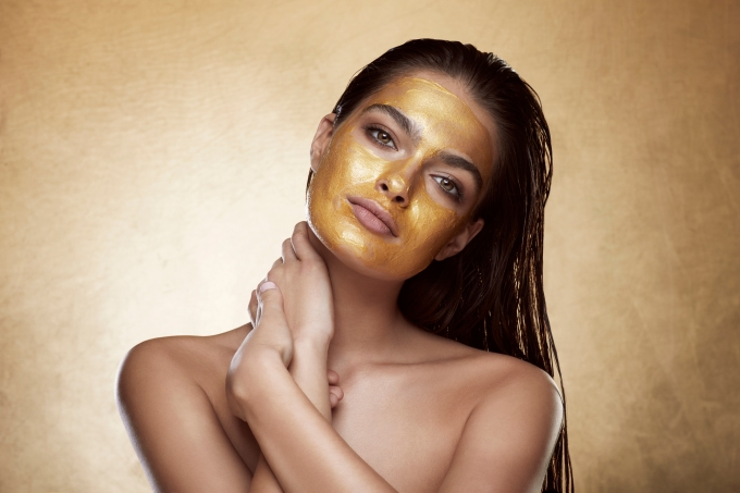 Model with gold mask-rgb